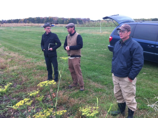 Big River's farm manager explains the layout to John and Paul.