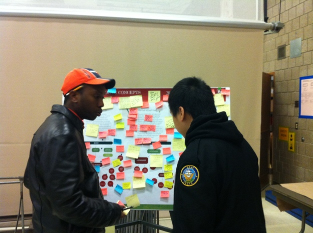 Community Ambassadors Abdi and Chong staff the program feedback station.